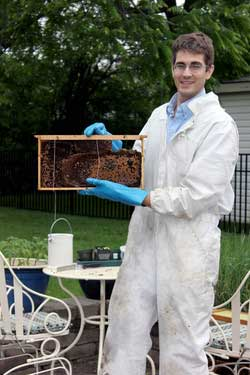 Mark Vanderwerp holds the rescued bee hive